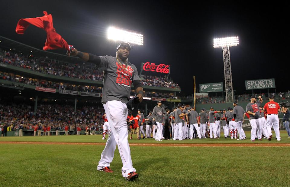 Boston Red Sox designated hitter David Ortiz celebrates after the Red Sox clinched the AL East title with a 6-3 win over the Toronto Blue Jays in a baseball game at Fenway Park, Friday, Sept. 20, 2013, in Boston. (AP Photo/Charles Krupa)