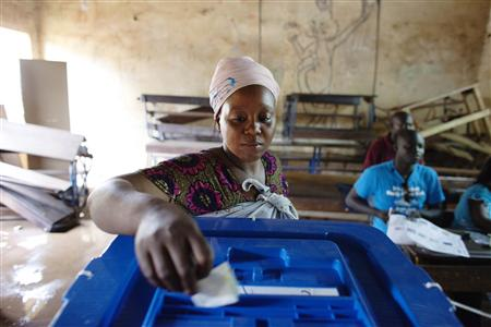 A woman votes during the second round of presidential elections in Bamako