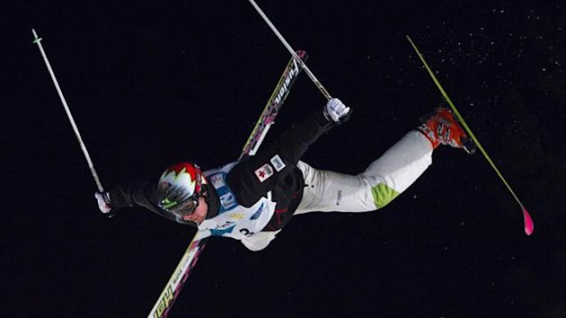 Canada's Alexandre Bilodeau goes airborne during the men's Dual Moguls