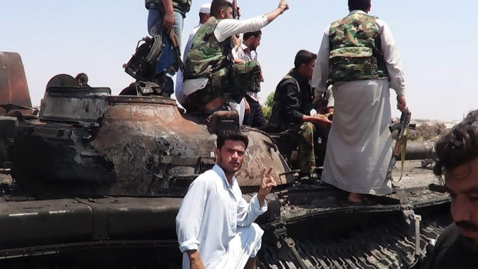 """This citizen journalism image provided by Shaam News Network SNN, taken on Tuesday, July 3, 2012, purports to show Free Syrian Army soldiers sitting on a military tank in Idlib, north Syria. The head of Syria's U.N. observer mission says violence in the country has reached """"unprecedented"""" levels and he called for an end to the bloodshed. (AP Photo/Shaam News Network, SNN)THE ASSOCIATED PRESS IS UNABLE TO INDEPENDENTLY VERIFY THE AUTHENTICITY, CONTENT, LOCATION OR DATE OF THIS HANDOUT PHOTO"""