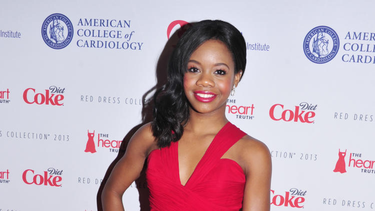 Gabby Douglas attends the Red Dress Collection 2013 Fashion Show, on Wednesday, Feb. 6, 2013 in New York. (Photo by Charles Sykes/Invision/AP)