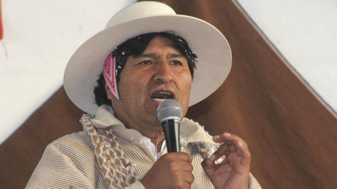 In this photo released by the state news agency, Bolivian Information Agency, Bolivia's President Evo Morales speaks during a meeting with Uru-Chipaya indigenous in Chipaya, Bolivia, Saturday, July 6, 2013. Morales announced NSA leaker Edward Snowden is welcome in Bolivia. Morales made the offer Saturday as a protest against the U.S. and European nations he accuses of temporarily blocking his flight home from a Moscow summit because they suspected he might have Snowden on board. (AP Photo/Bolivian Information Agency, Enzo De Luca)