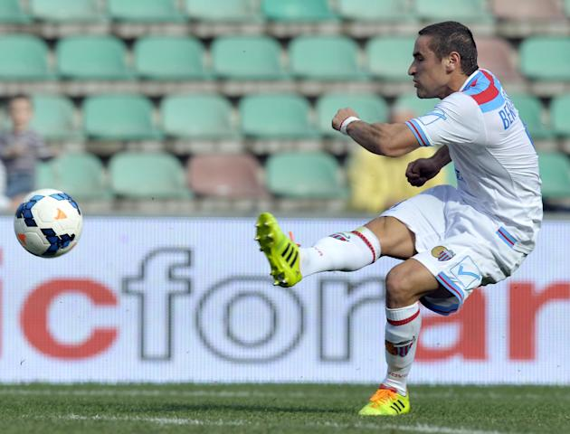 Catania's Gonzalo Bergessio of Argentina, scores against Sassuolo during their Serie A soccer match at Reggio Emilia's Mapei stadium, Italy, Sunday, March 16, 2014
