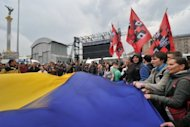 Protesters wave a giant Ukrainian flag during a protest in Kiev on June 5 against a bill increasing the role of the Russian language in the linguistically-divided country. The Euro 2012 football tournament is providing the perfect platform to air a range of local and national grievances in the former Soviet state