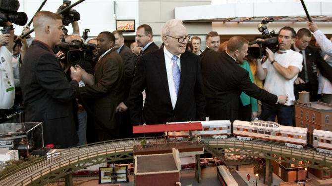 FILE - In this Saturday, May 1, 2010, file photo, Berkshire Hathaway Chairman and CEO Warren Buffett surveys a model railroad prior to participating in the annual shareholders meeting, in Omaha, Neb. Warren Buffett's company announced Wednesday, Dec. 26, 2012, that it has sold two short-line railroads it recently discovered it owned to satisfy regulators who might have reviewed Berkshire Hathaway's 2010 acquisition of the Burlington Northern Santa Fe railroad. (AP Photo/Nati Harnik, File)