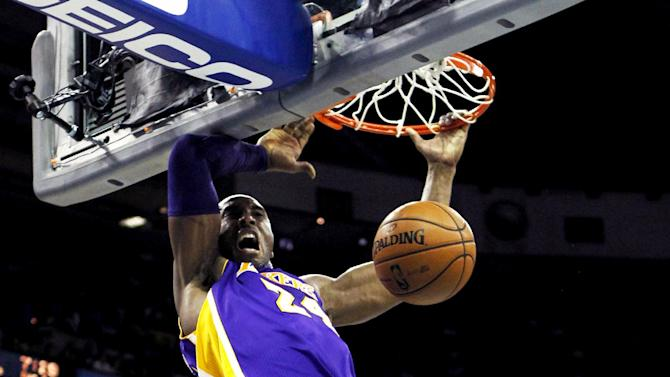 Los Angeles Lakers ing guard Kobe Bryant (24) dunks in the first half of an NBA basketball game against the New Orleans Hornets in New Orleans, Wednesday, Dec. 5, 2012. (AP Photo/Gerald Herbert)