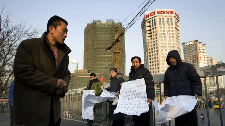 FILE - In this file photo taken Tuesday, Jan. 8, 2008, Chinese infected with HIV from the Henan province, beg for help on a street in Beijing, China. Li Keqiang, the man lined up to be China's next premier was governor of the agricultural province of Henan in 1998 during an unusual explosion of AIDS cases. (AP Photo/Ng Han Guan, File)