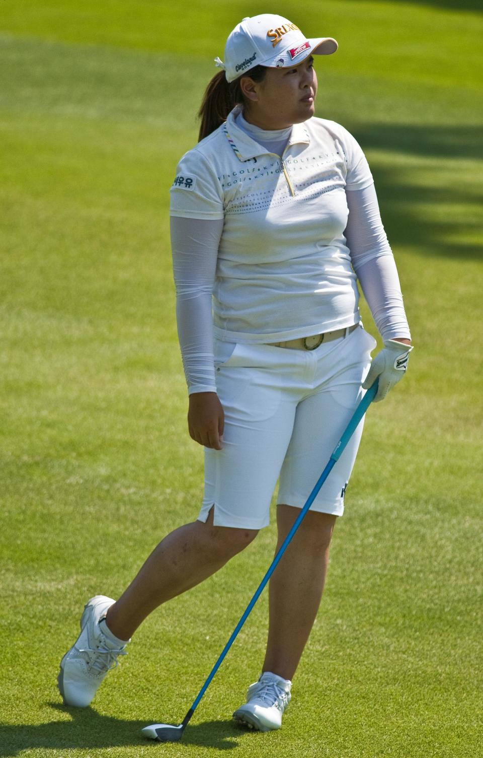 Inbee Park of South Korea, watches her shot from the second fairway during the second round of the LPGA NW Arkansas Championship golf tournament in Rogers, Ark., Saturday, June 30, 2012. (AP Photo/April L. Brown)