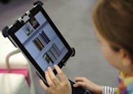 Even as e-book sales surge, Americans are slow to look to their public libraries to take advantage of the format, a study showed Friday