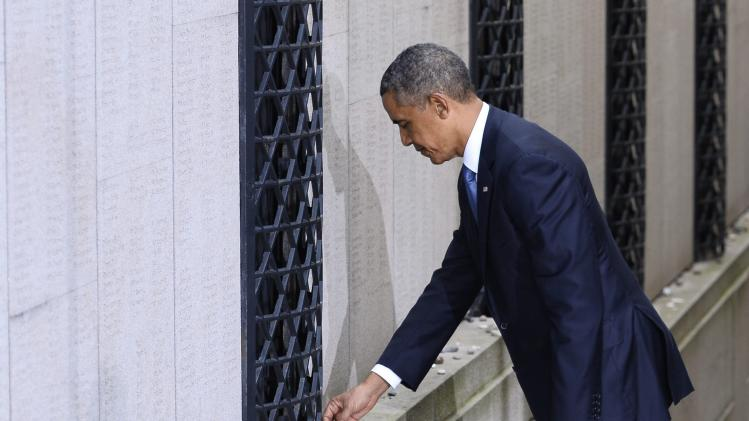 U.S. President Barack Obama places a stone in memory of Swedish diplomat Raould Wallenberg at the Stockholm Synagogue