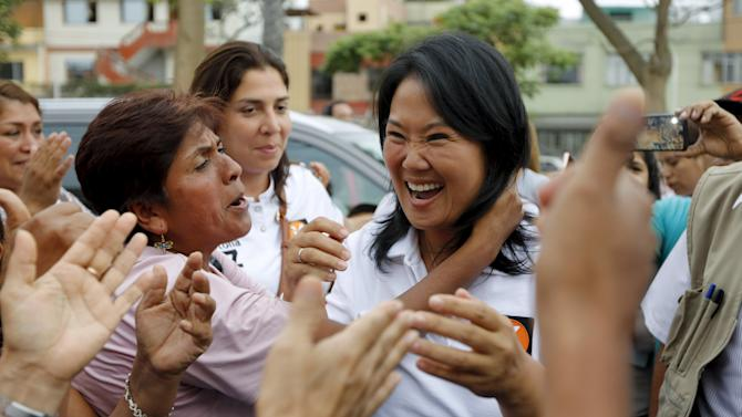 Peruvian presidential candidate Keiko Fujimori greets supporters at a local campaign at La Victoria district of Lima