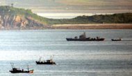 This file photo shows a North Korean navy patrol boat, seen amongst North Korean fishing boats, in 2009, from the South Korea-controlled Yeonpyeong island near the disputed waters of the Yellow Sea, the scene of previous inter-Korean clashes