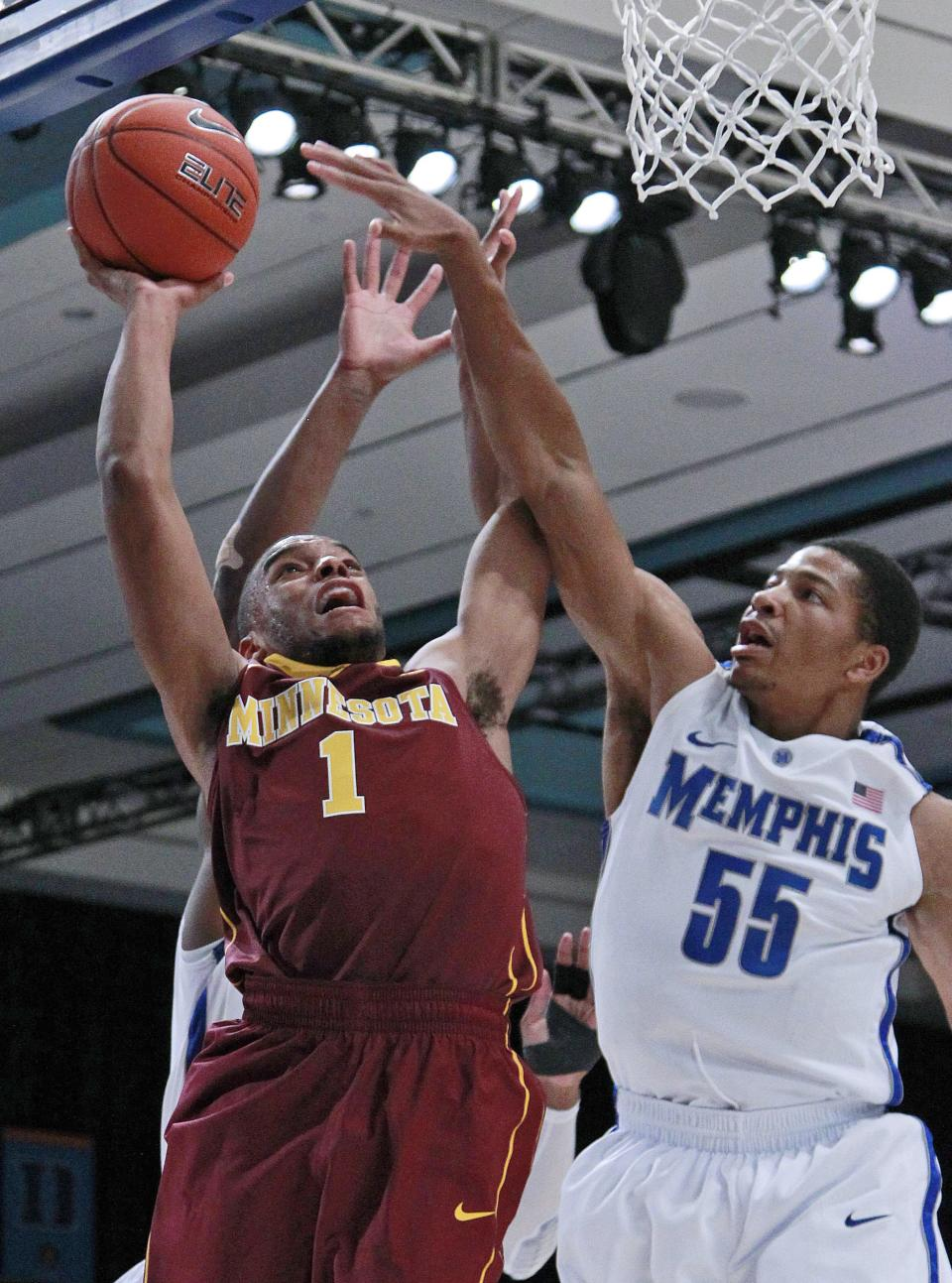 Minnesota guard Andre Hollins (1) goes to the basket as Memphis guard Geron Johnson (55) defends during the first half of an NCAA college basketball game at the Battle 4 Atlantis tournament, Friday, Nov. 23, 2012 in Paradise Island, Bahamas. (AP Photo/John Bazemore)