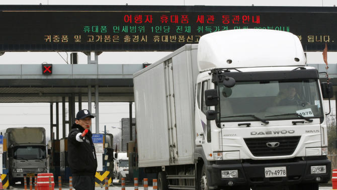 """South Korean vehicles return from the North Korean city of Kaesong at the customs, immigration and quarantine office in Paju, South Korea, near the border village of Panmunjom, Monday, April 1, 2013. North Korea warned South Korea on Saturday that the Korean Peninsula had entered """"a state of war"""" and threatened to shut down a border factory complex that's the last major symbol of inter-Korean cooperation.  (AP Photo/Ahn Young-joon)"""