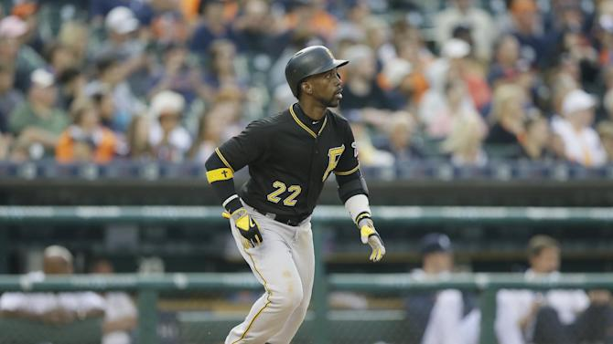 Pittsburgh Pirates' Andrew McCutchen watches the flight of his ball during the second inning of a baseball game against the Detroit Tigers, Tuesday, June 30, 2015, in Detroit. (AP Photo/Carlos Osorio)