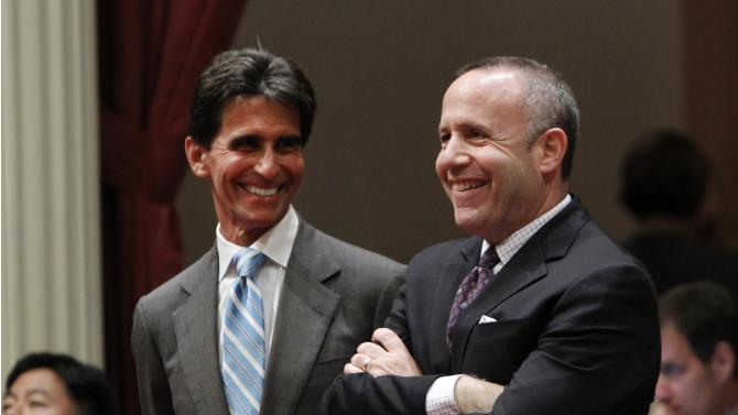 Senate Mark Leno, D-San Francisco, left, and Senate President Pro Tem Darrell Steinberg, right, smile as the vote is taken for a bill authorizing about $4.5 billion in funding for a high-speed rail system, at the Capitol in Sacramento, Calif., Friday, July 6, 2012.   The bill, which would allow the state to begin selling $2.6 billion in voter -approved bonds, was approved by a 21-16 vote and now goes to Gov. Jerry Brown who has supports the measure.(AP Photo/Rich Pedroncelli)