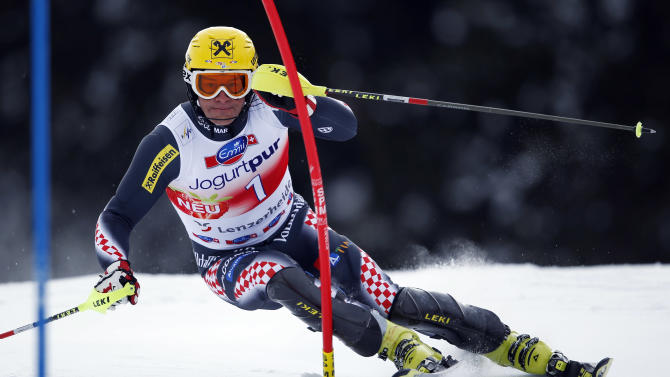 Ivica Kostelic from Croatia speeds down the course during the men's slalom for the finals of the Alpine skiing World Cup in Lenzerheide, Switzerland, Sunday,March.17,2013.(AP Photo/Shinichiro Tanaka)