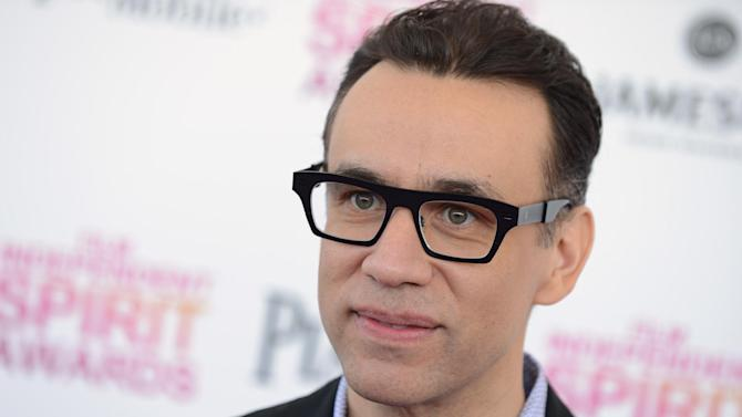 "FILE - In this Feb. 23, 2013 file photo, actor Fred Armisen arrives at the Independent Spirit Awards in Santa Monica, Calif. Seth Meyers says former comedy colleague Fred Armisen will lead the band when he takes over NBC's ""Late Night."" Meyers tweeted Monday, Feb. 10, 2014, that his former ""Saturday Night Live"" castmate will ""curate and lead"" the band, running it even while away shooting ""Portlandia,"" Armisen's IFC comedy series. NBC confirmed the news. Armisen is best known as a comic performer from ""Portlandia"" and his decade at ""SNL."" But he began show business as a drummer, principally for the punk-rock band Trenchmouth in the 1990s. He will handle vocals and guitar for ""Late Night's"" 8G Band. (Photo by Jordan Strauss/Invision/AP, File)"