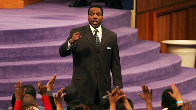 """In this Wednesday, Nov. 7, 2007 photo, Rev. Creflo Dollar gives his Wednesday night service at World Changers Church International, in College Park, Ga. Dollar has been arrested after authorities say he slightly hurt his 15-year-old daughter in a fight at his metro Atlanta home. Fayette County Sheriff's Office investigator Brent Rowan says deputies responded to a call of domestic violence at the home around 1 a.m. Friday, June 8, 2012. Rowan says the 50-year-old pastor and his daughter were arguing over whether she could go to a party when Dollar """"got physical"""" with her, leaving her with """"superficial injuries."""" (AP Photo/Atlanta Journal-Constitution, Pouya Dianat) MARIETTA DAILY OUT; GWINNETT DAILY POST OUT; LOCAL TV OUT; WXIA-TV OUT; WGCL-TV OUT"""