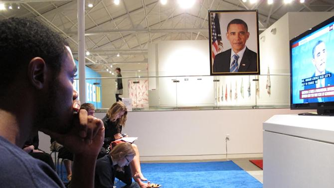 Drew Roston, 23, listens to Republican nominee Mitt Romney during a presidential debate event at the Contemporary Art Museum in Raleigh, N.C., on Wednesday, Oct. 3, 2012. Roston supports President Barack Obama but thought Romney had a strong performance. (AP Photo/Allen Breed)