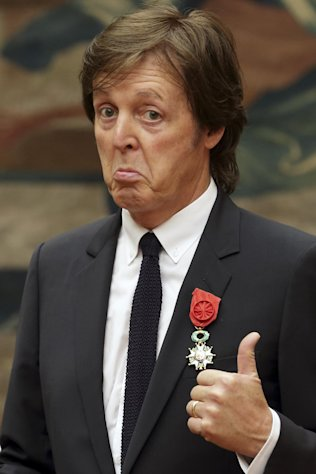 British musician Paul McCartney poses during a decoration ceremony photo session at the Elysee Palace in Paris, Saturday, Sept. 8, 2012. Hollande decorated the former Beatle with a Legion of Honor award, France's highest public distinction which has been awarded to the likes of actor Clint Eastwood and singer Liza Minnelli and Barbara Streisand. (AP Photo/ Philippe Wojazer, Pool)