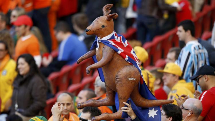 Australia fans hold inflatable kangaroo before the team's 2014 World Cup Group B soccer match against Netherlands in Porto Alegre