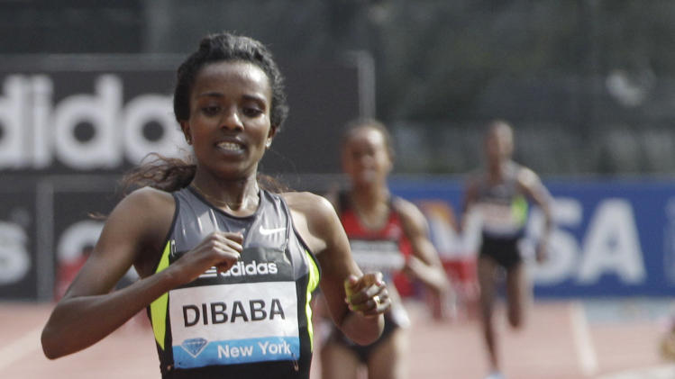 Tirunesh Dibaba wins the women's 5,000 meters at the Adidas Grand Prix track and field meet, Saturday, June 9, 2012 in New York. (AP Photo/Mary Altaffer)