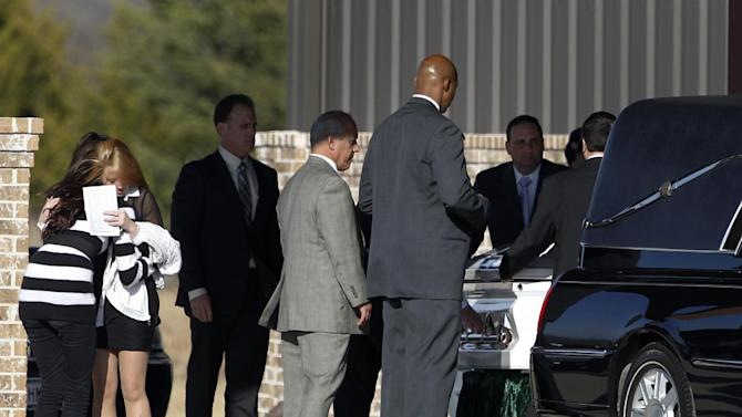 Mourners embrace as the casket of Kasandra Perkins is loaded into a waiting hearse outside of Ridgeview Family Fellowship Church following a funeral service, Thursday, Dec. 6, 2012, in Blue Ridge, Texas. Perkins was shot and killed last Saturday by her boyfriend Jovan Belcher, a Kansas City Chiefs football player. AP Photo/Tony Gutierrez)