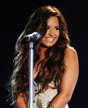 Demi Lovato is all smiles onstage during the 2011 VH1 Do Something Awards at the Hollywood Palladium in Hollywood, Calif. on August 14, 2011  -- Getty Images