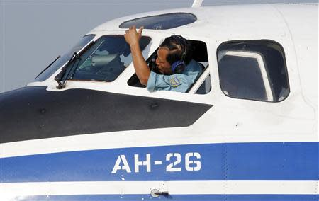 Pilot of a Vietnam Air Force search and rescue aircraft cleans windshield of plane, before taking off on mission to find Malaysia Airlines flight MH370 that disappeared, at a military airport in Vietnam's Ho Chi Minh City