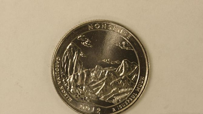 This undated photo provided on Wednesday, Dec. 19, 2012 by the U.S. Mint in Philadelphia shows a nonsense test piece.  The Mint has been testing different materials to fiend less expensive ways to make coins. (AP Photo U.S. Mint)
