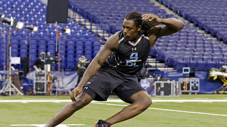 South Carolina defensive lineman Jadeveon Clowney runs a drill at the NFL football scouting combine in Indianapolis, Monday, Feb. 24, 2014
