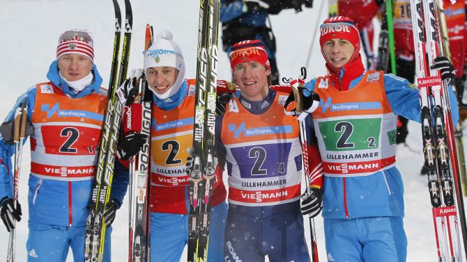 Members of Russian team celebrate on the podium after winning the men's 4 x 7.5km relay skiing competition at FIS World Cup in Lillehammer