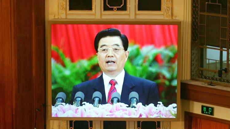 FILE - In this Oct. 15, 2007 file photo, a live image of Chinese leader Hu Jintao is seen on a screen above delegates as he speaks at the opening of the 17th Communist Party Congress in Beijing's Great Hall of the People. As Hu steps down as head of China's Communist Party after 10 years in power, he's hearing something unusual for a Chinese leader: sharp criticism. (AP Photo/Greg Baker, File)