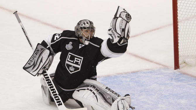 Los Angeles Kings' goalie Jonathan Quick catches a shot on goal in the first period during Game 4 of the NHL hockey Stanley Cup finals against the New Jersey Devils, Wednesday, June 6, 2012, in Los Angeles.  (AP Photo/Jae C. Hong)