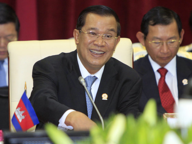 FILE - In this April 3, 2012 file photo, Cambodian Prime Minister Hun Sen speaks during an opening a plenary session at the 20th ASEAN Summit at the Peace Palace, in Phnom Penh Cambodia. The Asia's longest serving ruler has set what appears to be a personal record for his longest public speech: 5 hours and 20 minutes. Cambodian Prime Minister Hun Sen spoke to the lower house of parliament in a nationally televised speech Thursday, Aug. 9, 2012, that was mandatory viewing for civil servants. (AP Photo/Heng Sinith, File)