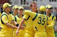 Australia&#39;s Shane Watson (left) Brett Lee (3rd R) celebrates a wicket with team-mates during the first ODI at Lord&#39;s cricket ground in north-west London on June 29. Lee and Watson both had their tour of England cut short by calf problems on Monday as they were ruled out of Tuesday&#39;s fifth one-day international at Old Trafford