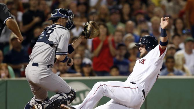 Boston Red Sox's Jarrod Saltalamacchia, right, scores on a sacrifice fly by Stephen Drew as New York Yankees catcher Chris Stewart waits for the throw in the fourth inning of a baseball game, Sunday, Aug. 18, 2013, in Boston . (AP Photo/Michael Dwyer)
