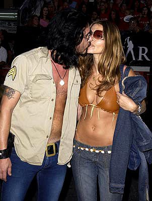 Gilby Clarke and gal Daniella at the Westwood premiere of Warner Brothers' Rock Star