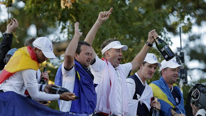 Europe's Sergio Garcia, left to right, Graeme McDowell, Ian Poulter, Justin Rose and Peter Hanson celebrate after winning the Ryder Cup PGA golf tournament Sunday, Sept. 30, 2012, at the Medinah Country Club in Medinah, Ill. (AP Photo/Charlie Riedel)