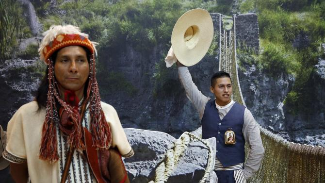 Performers promoting Peru pose during opening day at Madrid's International Tourism Trade Fair
