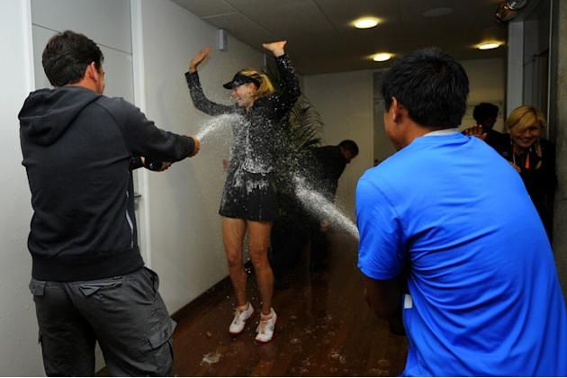 Maria Sharapova Of Russia Is Sprayed With Champagne By Her Physical Trainer Juan Reque (L) And Her Hitting Partner Getty Images