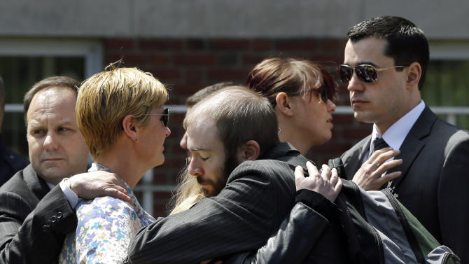 Mourners hug as they leave the funeral for Boston Marathon bomb victim Krystle Campbell, 29, at St. Joseph's Church in Medford, Mass. Monday, April 22, 2013. Hundreds of family and friends packed the church in Medford, Mass., for Campbell's funeral, while dozens more waited outside after being turned away. (AP Photo/Elise Amendola)
