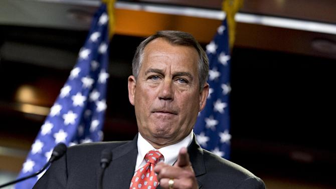 """House Speaker John Boehner of Ohio gestures as he speaks to reporters on Capitol Hill in Washington, Thursday, Nov. 29, 2012, after private talks with Treasury Secretary Timothy Geithner on the fiscal cliff negotiations. Boehner said no substantive progress has been made between the White House and the House"""" in the past two weeks.  (AP Photo/J. Scott Applewhite)"""