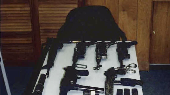 """This undated photo released by the U.S. Attorney's Office and presented as evidence during the trial of James """"Whitey"""" Bulger in U.S. District Court in Boston, Thursday, June 13, 2013, shows several weapons from an arsenal that investigators say the Bulger and his gang owned. Bulger is charged with a long list of crimes in a 32-count racketeering indictment, including participating in 19 killings in the 1970s and '80s. (AP Photo/U.S. Attorney's Office)"""