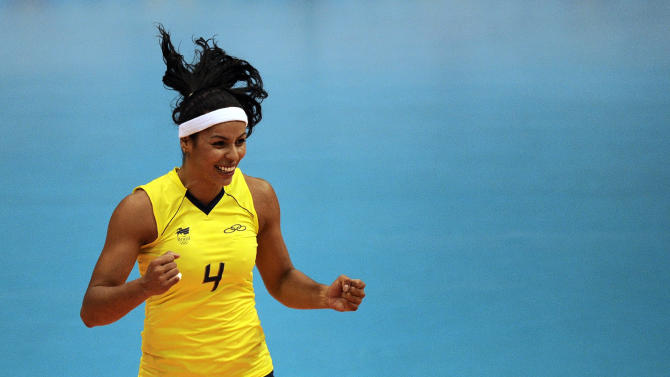 Paula Pequeno from Brazil reacts the ball during a women's volleyball final match against Cuba at the Pan American Games in Guadalajara, Mexico, Thursday, Oct. 20, 2011. Brazil won 3-2. (AP Photo/Daniel Ochoa de Olza)