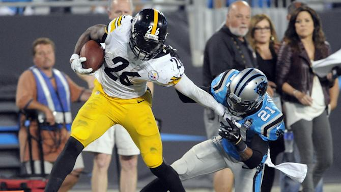 Pittsburgh Steelers' Le'Veon Bell (26) is tackled by Pittsburgh Steelers' Robert Golden (21) during the second half of an NFL football game in Charlotte, N.C., Sunday, Sept. 21, 2014