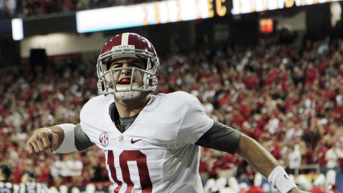 Alabama quarterback AJ McCarron (10) reacts after an Alabama field goal against Georgia during the first half of the Southeastern Conference championship NCAA college football game, Saturday, Dec. 1, 2012, in Atlanta. (AP Photo/Jamie Martin)