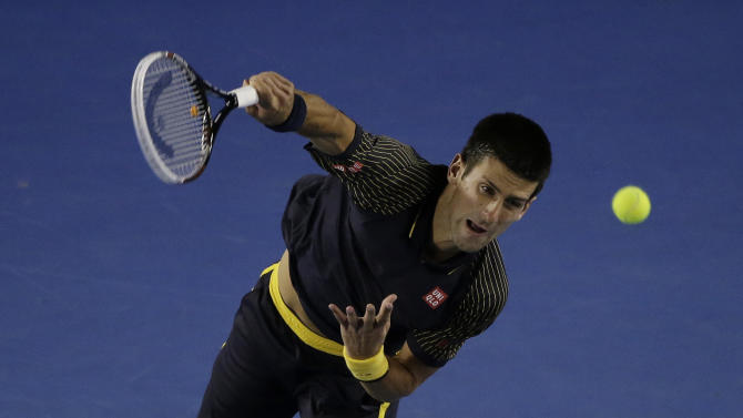 Serbia's Novak Djokovic serves to Ryan Harrison of the US during their second round match at the Australian Open tennis championship in Melbourne, Australia, Wednesday, Jan. 16, 2013. (AP Photo/Rob Griffith)