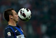 Inter Milan's forward Antonio Cassano eyes the ball during the Italian Serie A football match between AC Milan and Inter Milan at the San Siro stadium in Milan. Ten-man Inter Milan survived a second-half assault by city rivals AC Milan to win 1-0 and claim their 50th Milan derby win in Serie A